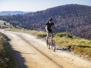 Cyclocross rider on cycling tour near Grand Ballon, Vosges, France — Stockfoto