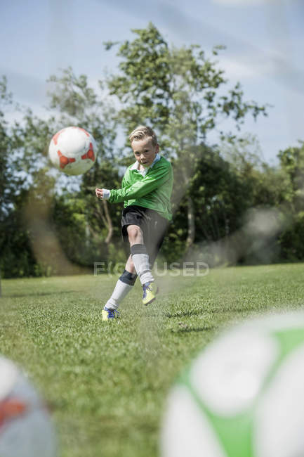 Junior soccer player practicing penalty — Stock Photo