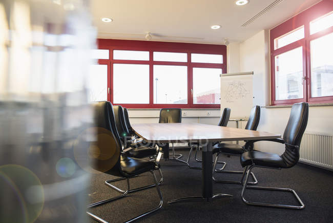 Empty office with conference table — Stock Photo