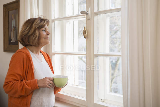Senior woman having cup of tea — Stock Photo