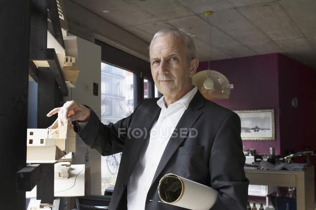 Senior architect with architectural model — Stock Photo