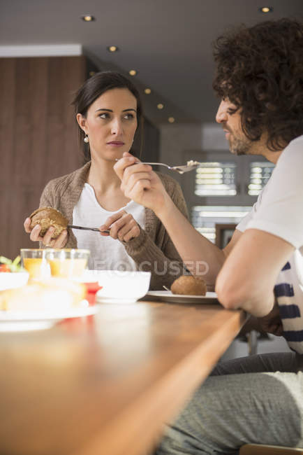 Couple having breakfast at dining table — Stock Photo