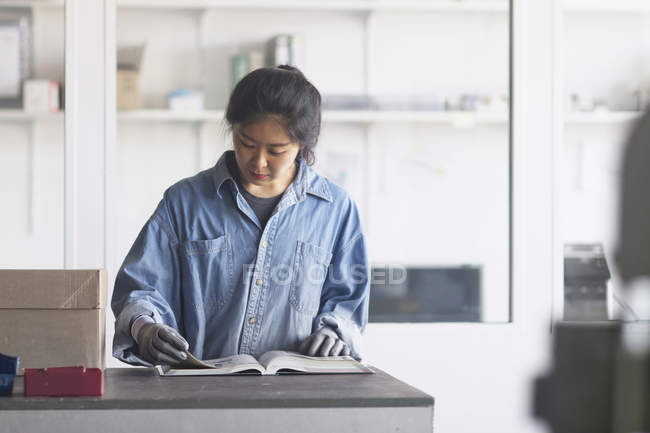 Female engineer reading book — Stock Photo