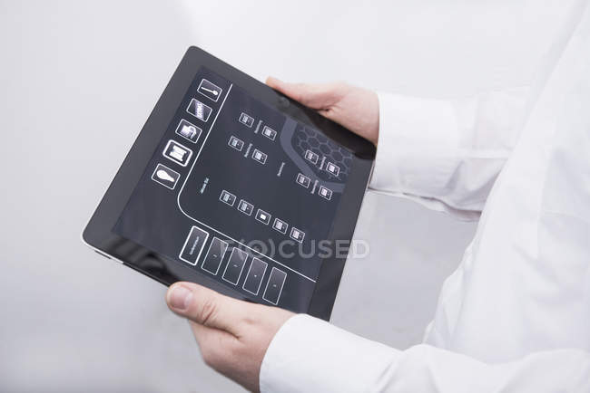 Man operating digital tablet in office — Stock Photo