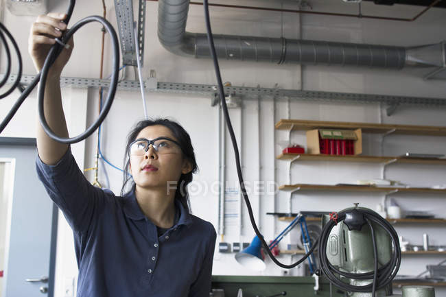 Female engineer checking cables — Stock Photo