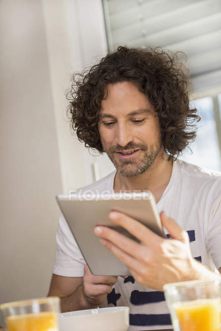 Mid adult man using a tablet — Stock Photo