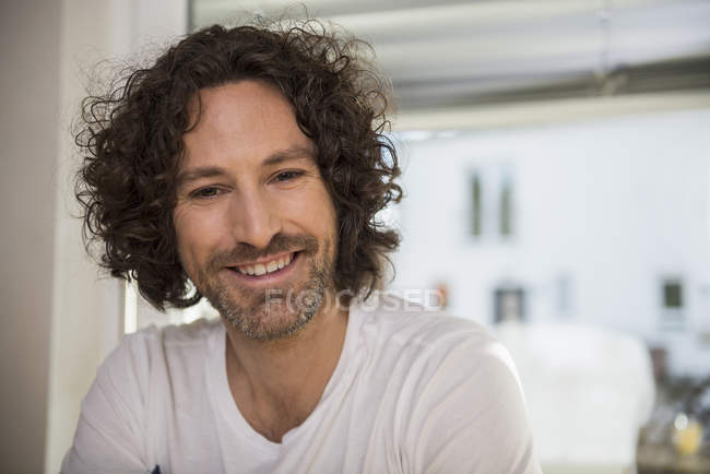 Mid adult man smiling — Stock Photo