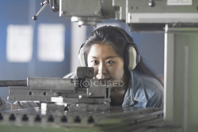 Female engineer wearing headphones and working — Stock Photo