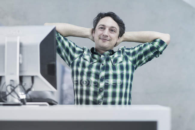 Man sitting in the office and dreaming — Stock Photo