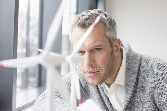 Businessman looking on wind turbines — Stock Photo