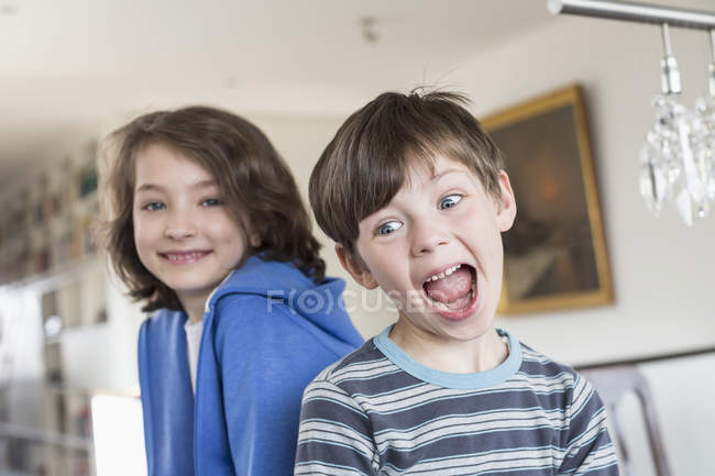 Boy making funny faces — Stock Photo