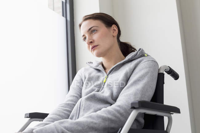 Sad woman in wheelchair — Stock Photo