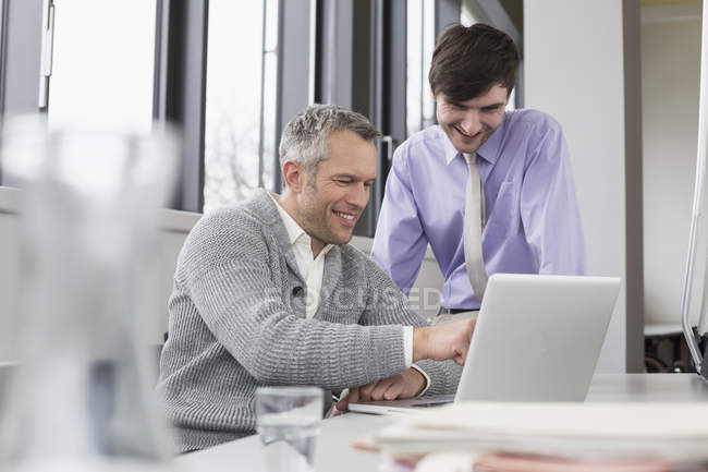 Businessmen working together with laptop — Stock Photo