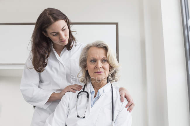 Female doctor consoling colleague — Stock Photo