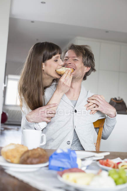 Happy Couple sharing breakfast — Stock Photo