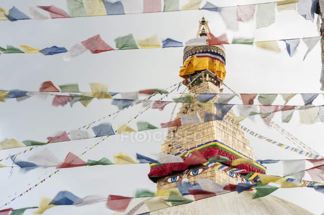 Stupa sanctuary with prayer flags — Stock Photo