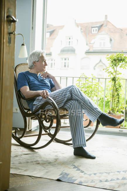 Man sitting in rocking chair — Stock Photo