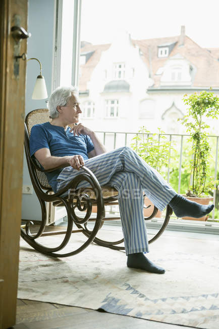 Man sitting in rocking chair — Stock Photo