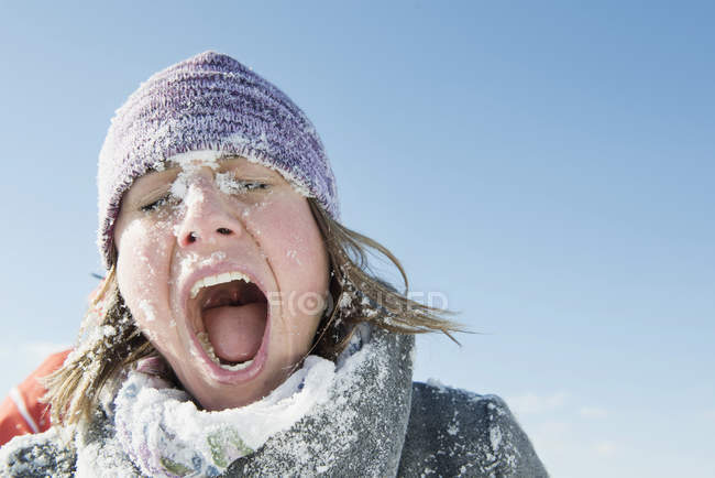 Woman hit by snowball — Stock Photo