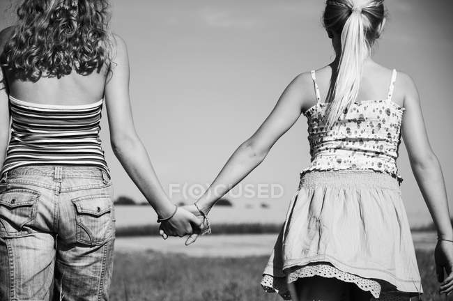 Two girls holding hand in hand — Stock Photo