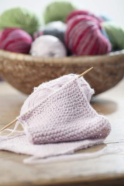 Balls of wool with knitting needle — Stock Photo