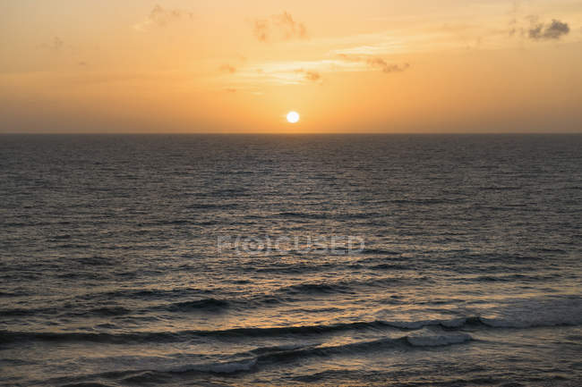 Scenic view of sunset over sea — Stock Photo