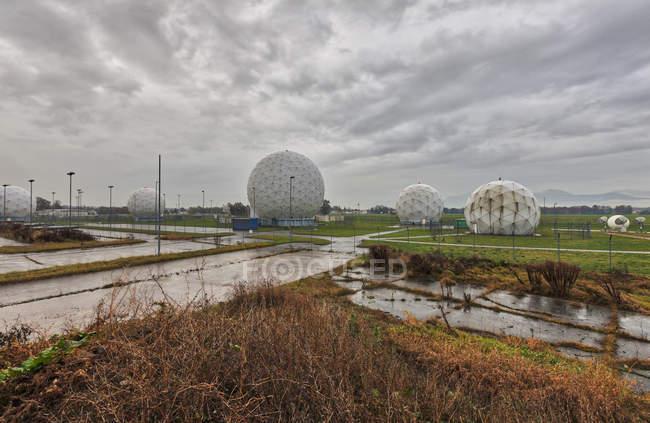 Radar Domes against cloudy sky — Stock Photo