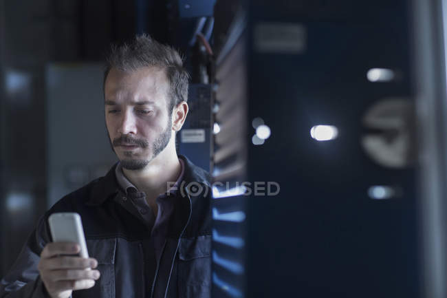 Engineer holding remote control — Stock Photo