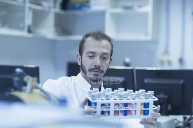Scientist examining test tube — Stock Photo