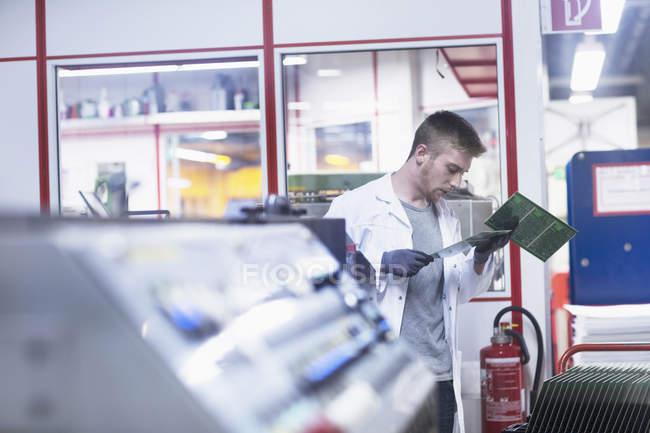 Engineer examining circuit board — Stock Photo