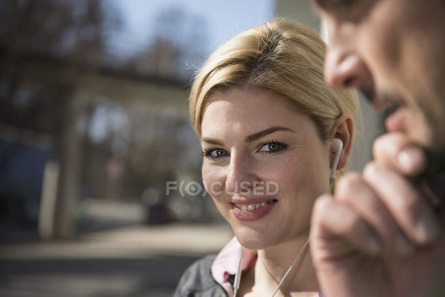 Man with woman listening music on headphones — Stock Photo