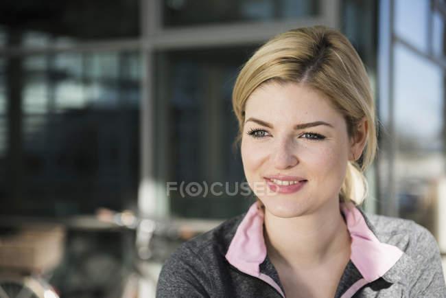 Woman in sportswear looking away — Stock Photo