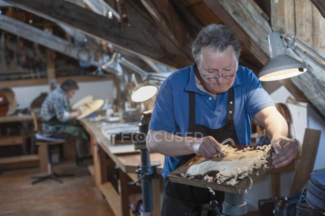 Craftsmen working at workshop — Stock Photo