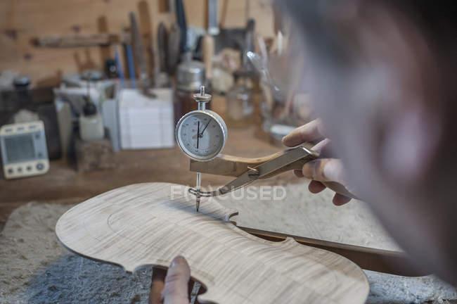 Violin maker measuring — Stock Photo