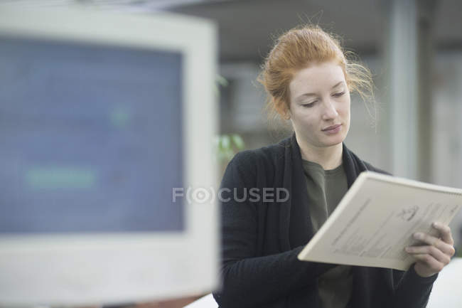 Contemplative worker holding document — Stock Photo