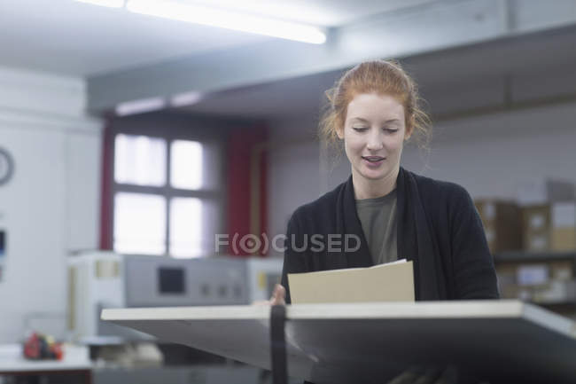 Print worker holding document — Stock Photo