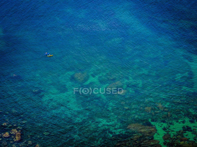 People kayaking on clear blue water — Stock Photo