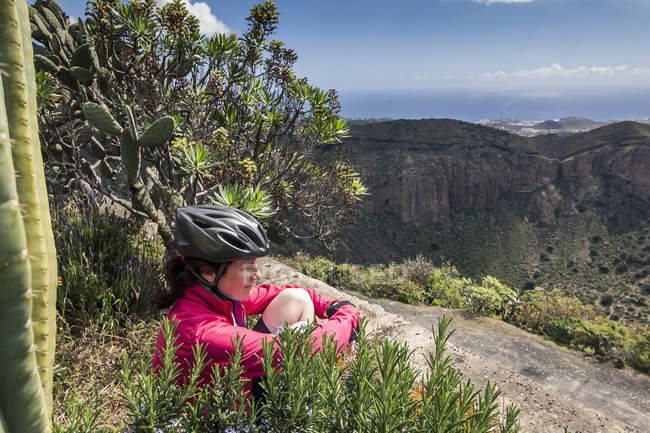 Mountain biker looking at distance — Stock Photo