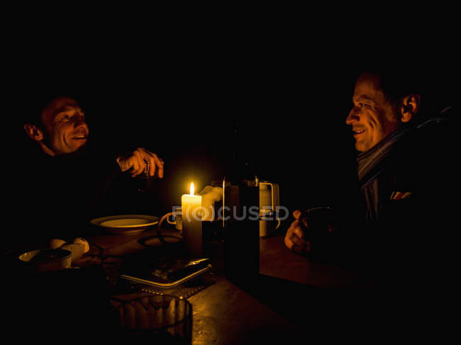 Two men discussing over dinner — Stock Photo
