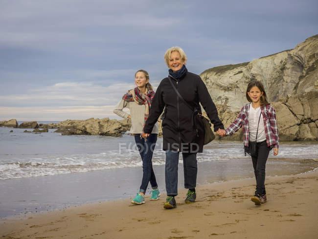 Grandmother walking with girls — Stock Photo