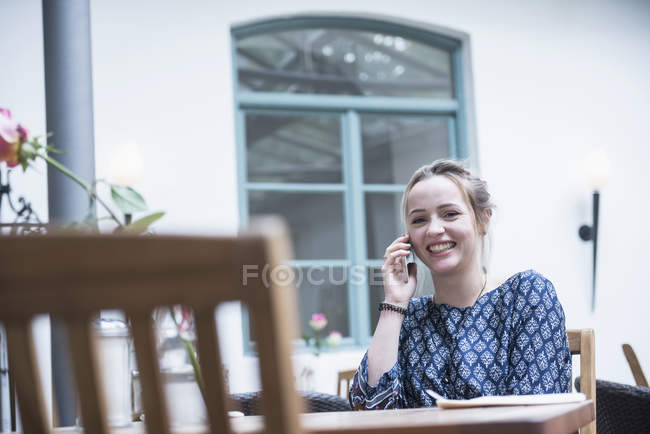 Woman smiling while using mobile phone — Stock Photo