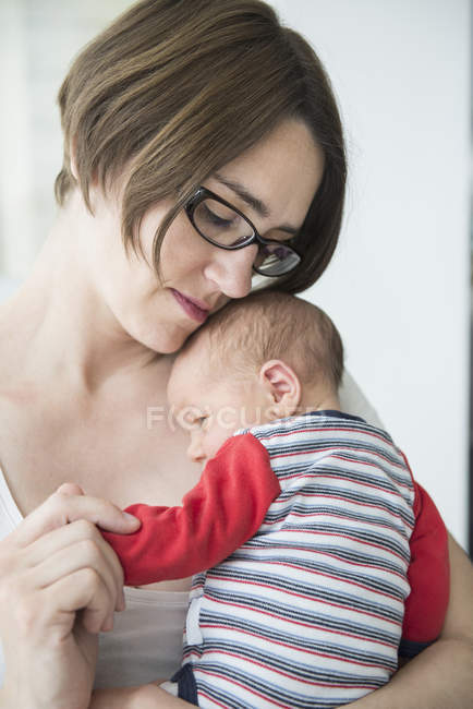 Close-up view of mother holding baby boy in arms — Stock Photo