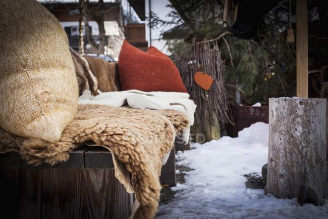 Cozy seat with fleece in snowy yard — Stock Photo