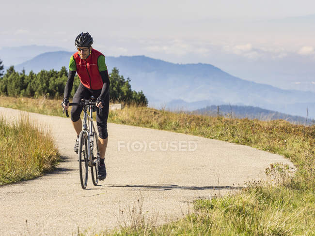 Man riding bicycle on cycling tour in Northern Black Forest, Germany