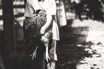 Petite poule de tenue garçon — Photo de stock