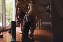 Happy brothers playing with rubber boots — Stock Photo
