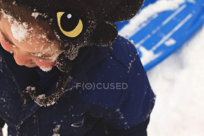 Funny smiling boy with snow on face — Stock Photo