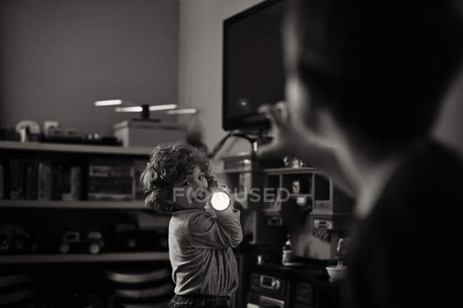 Adorable little boy holding flashlight — Stock Photo