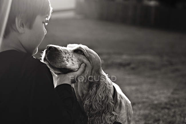 Adorable little boy and cute dog — Stock Photo