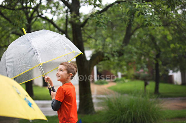 Cute smiling little boy with umbrella — Stock Photo